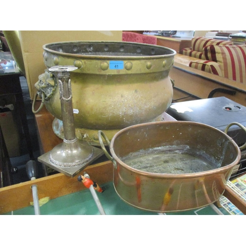 41 - A large brass and twin handled planter, a copper twin handled cooking pot and a white metal candlest...