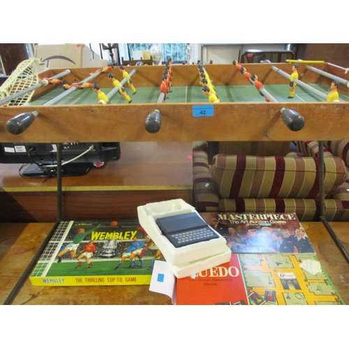 42 - A vintage Italian Arcofalc football table with a red shirt team and a yellow shirt team, together wi...
