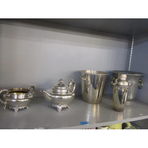 43 - Mixed metalware to include a cocktail shaker, ice buckets and a Victorian teapot Location: 2.2...