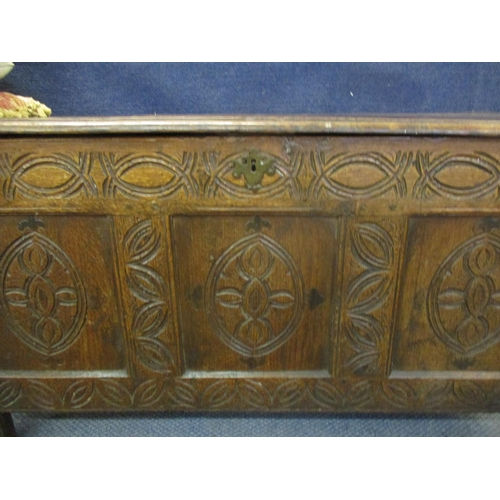 9 - Circa 1650's, a carved oak and tri-panelled coffer with candle box incorporated, 53cm x 110cm x 51cm...