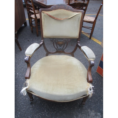48 - A Victorian walnut and marquetry armchair with a pierced splat and upholstered seat on square legs L...