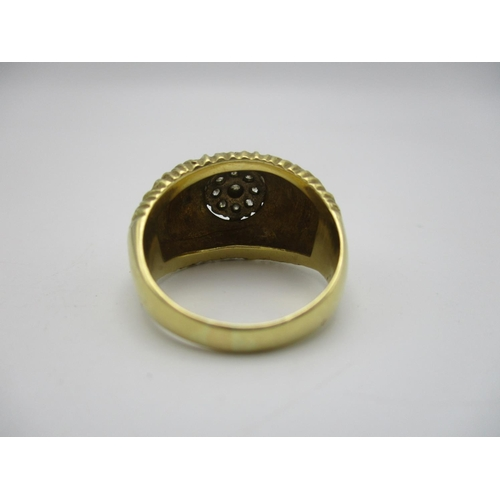 48 - An 18t gold and diamond Modernist style ring, with textured finish, centred with nine cluster diamon...