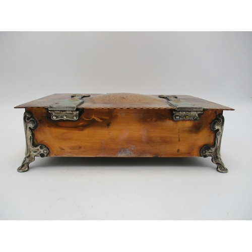 98 - A fine Arts and Crafts silver mounted copper box, the silver hallmarked by R H Halford & Sons, Londo...