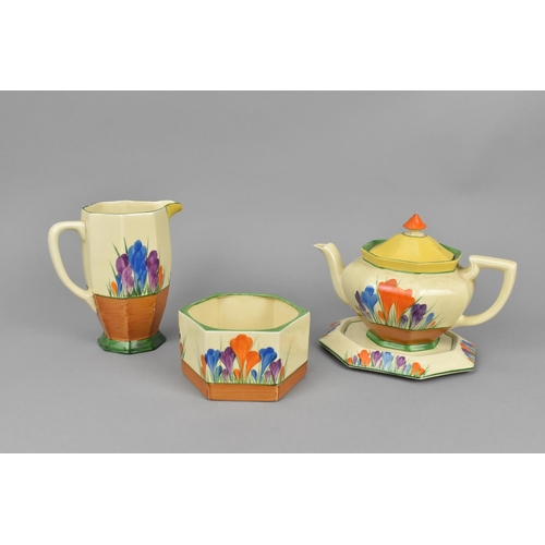 100 - A Clarice Cliff Athens shape teapot in the Autumn Crocus pattern, together with an octagonal base, a...