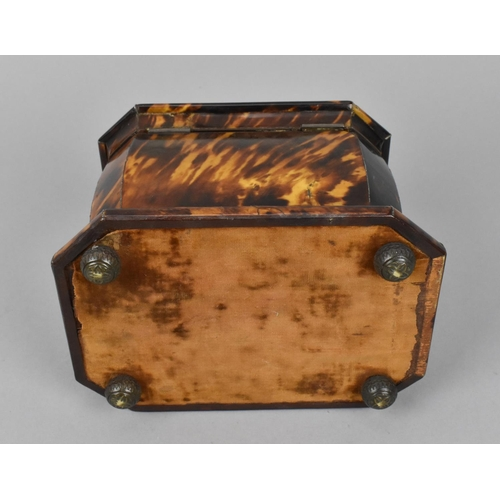 106 - A 19th century tortoiseshell tea caddy, of casket form with hinged lid lined with silk, opening to r...