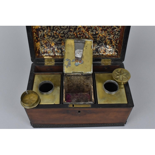 107 - A George III mahogany tea caddy, of rectangular form with hinged brass carrying handle, the concave ...