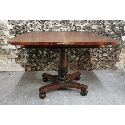 110 - A William IV rosewood fold over card table, the rectangular top raised on a turned column, standing ...