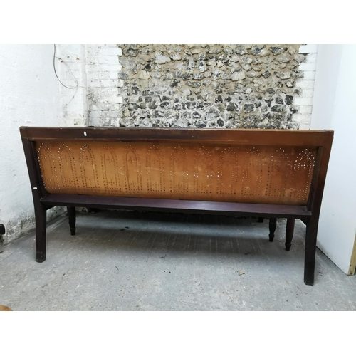 112 - A pair of Thonet style mahogany framed hall benches, with bend plywood seat designed with pierced ar...