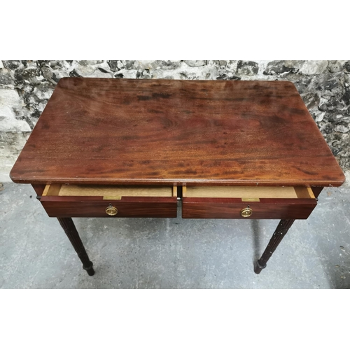 114 - A 19th century mahogany writing table in the manner of Gillows, the rectangular top above two drawer...