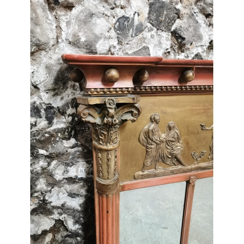 119 - A Regency style overmantle mirror, with Neoclassical relief frieze with lions pulling a chariot, fla...