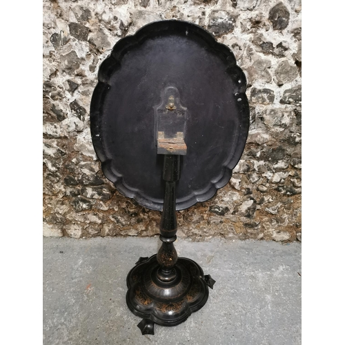 126 - A Victorian papier mache tilt top occasional table, with scalloped border, the centre painted with a...