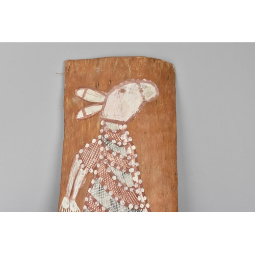 128 - An aboriginal painting on bark depicting a marsupial animal, 27 cm high x 79 cm long...