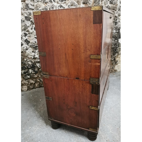 129 - A 19th century brass mounted teak campaign chest, in two parts, with secretaire drawer, two two shor...