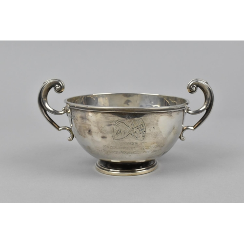15 - A George V silver twin handled pedestal bowl by David Munsey, London 1911, with scrolled handles eit...