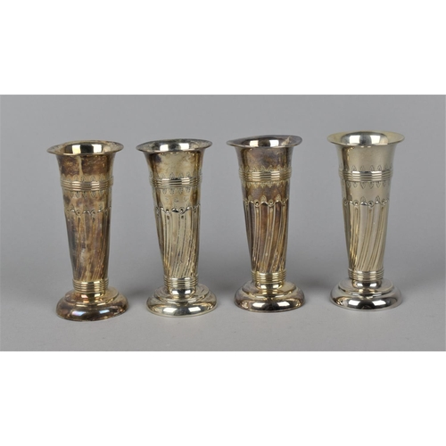 18 - A set of four Edward VII silver posy vases by William Aitken, Birmingham 1905, with everted rims, pa...
