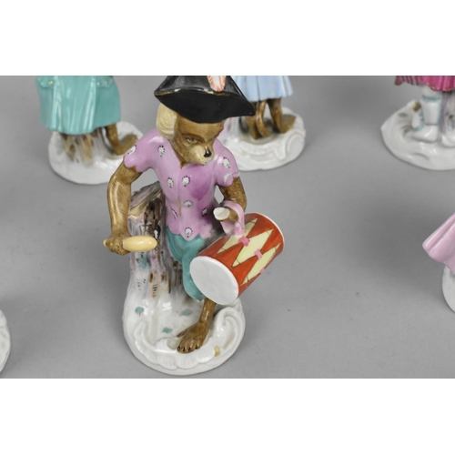 192 - A Meissen style German porcelain monkey band, comprising nine musical figures including the conducto...