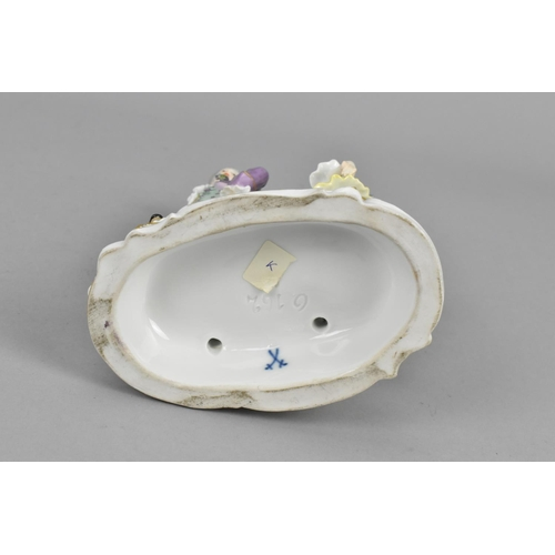193 - A 19th century Meissen porcelain model of a young couple dancing, raised on an oval base with encrus...