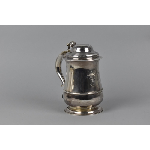 2 - A George II silver lidded tankard by Richard Gurney & Thomas Cook, London 1750, with a hinged, domed...