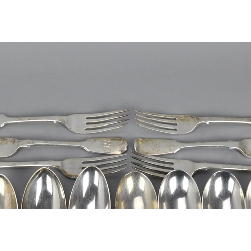 21 - A quantity of silver fiddle pattern flatware to include a pair of George III silver table spoons by ...