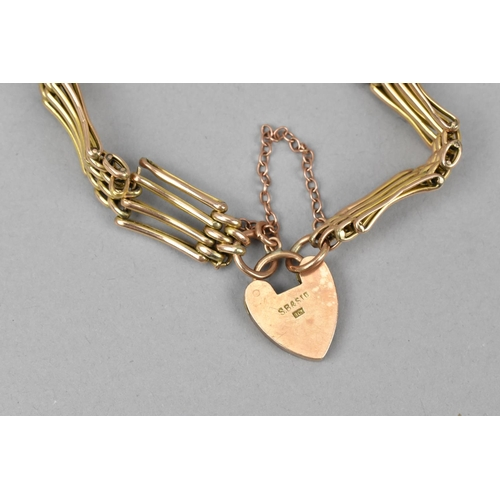 22 - A 9ct gold gate link bracelet, with heart shaped padlock clasp and safety chain, 13 g...