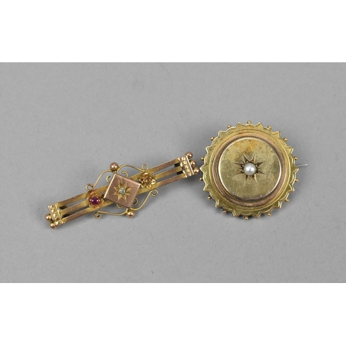 25 - A 9ct gold Edwardian bar brooch, inset with a central old cut diamond and flanked with a ruby to one...