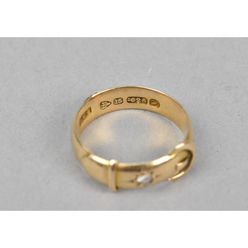29 - A 15ct gold buckle ring inset with a rough cut diamond, size L 1/2, 2 g, together with a 9ct gold ca...