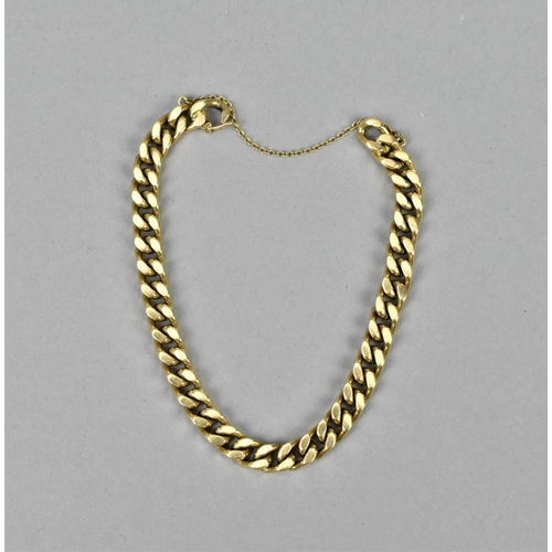 33 - A 9ct gold curb link bracelet, with safety chain, 18 cm long, 27 g...