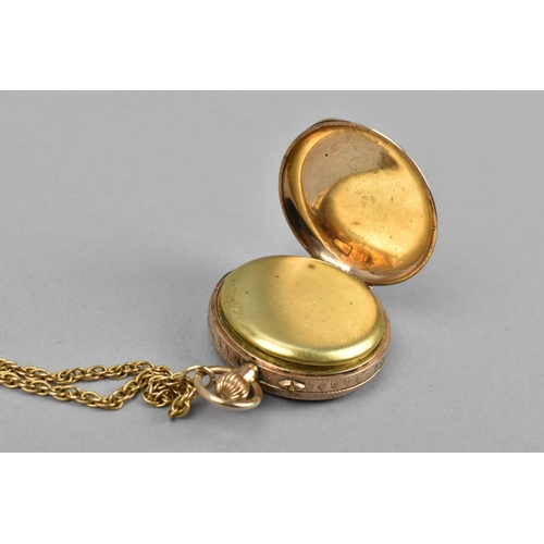 35 - Two gold cased ladies pocket watches, to include one with gold coloured face with floral detail, the...