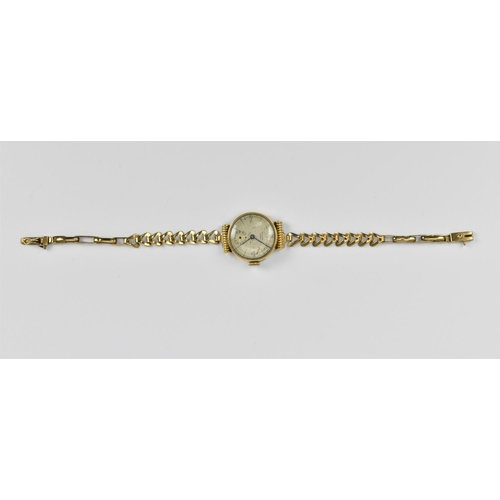 36 - A 9ct gold ladies wristwatch, the face signed 'Philippe', with box clasp, 18 cm long...