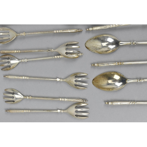 40 - A set of Continental silver cake forks and teaspoons, comprising twelve forks and ten spoons, of mat...