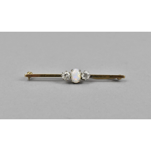 41 - A 9ct gold opal and sapphire bar brooch, the central cabochon opal flanked with white sapphires eith...