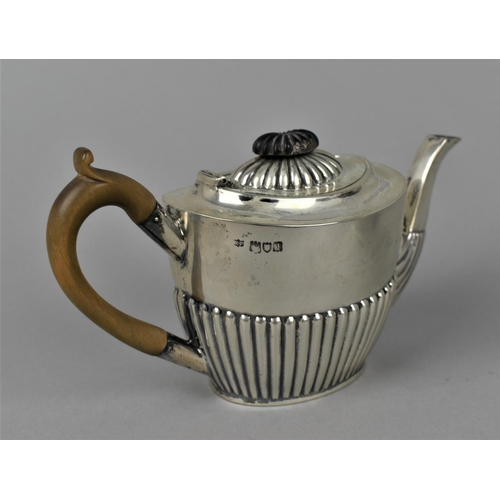 5 - A late Victorian silver teapot and sugar bowl by Robert Pringle & Sons, London 1899, with part flute...