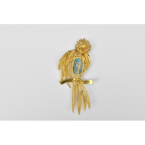 51 - A gold, ruby and turquoise brooch in the shape of a bird, with filigree detail to the head, body, wi...