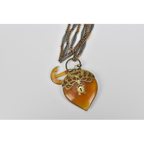 54 - A long mixed metal chain with gold mounted locket shaped pendant, the rose metal chain parts test as...