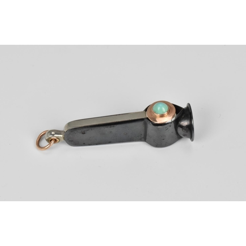 57 - An Art Deco ladies cigar cutter, mounted with gold and hardstone cabochon, 6 cm long, gold tests as ...