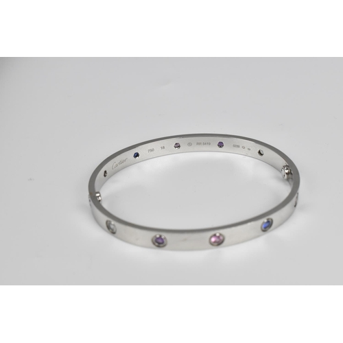 59 - An 18ct white gold Cartier love bracelet set with aquamarines, sapphires, spinels and amethysts, mar...