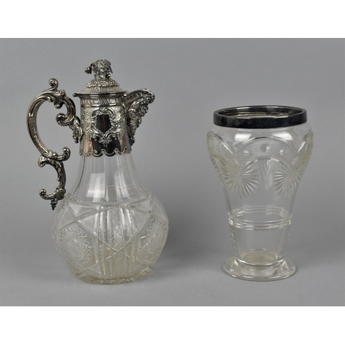 6 - A Victorian cut glass and silver plated claret jug, the baluster shaped body with hobnail detail and...
