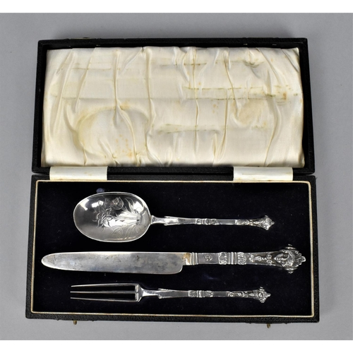 62 - A cased christening white metal cutlery set, with indistinct hallmarks, makers initials to the knife...