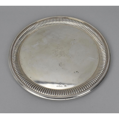 63 - A Victorian silver circular salver by Hukin & Heath, London 1891, with beaded rim and gadrooned bord...