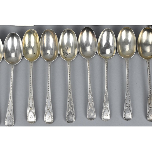 64 - A small collection of miscellaneous silver spoons to include a set of nine Mappin and Webb egg spoon...