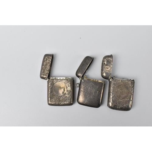 69 - A group of seven silver vesta cases, to include Victorian examples and early 20th century ones, earl...