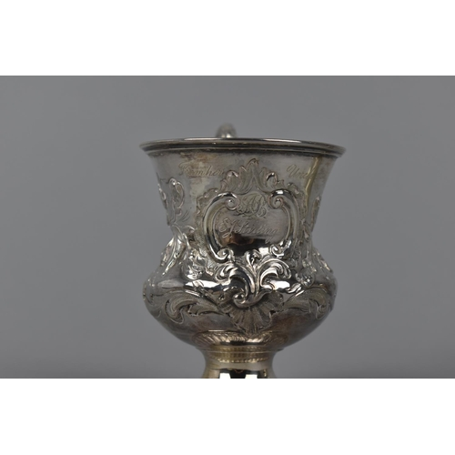 7 - A Victorian silver gilt christening cup by Charles Lias, London 1840, with embossed floral detail th...