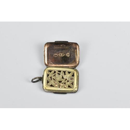 70 - A George III silver and silver gilt miniature vinaigrette by Samuel Pemberton, Birmingham 1810, of r...
