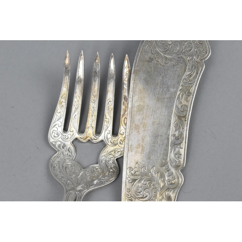 76 - A pair of Victorian silver fish servers by Josiah Williams & Co, Exeter 1854, with etched foliate de...