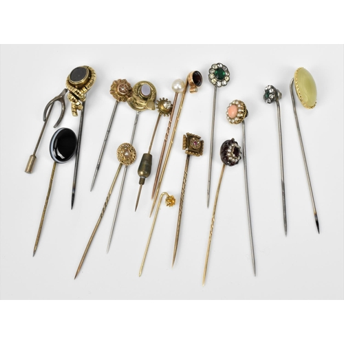 78 - A collection of jewelled stick pins, to include Victorian and later gold ones with diamond accents, ...
