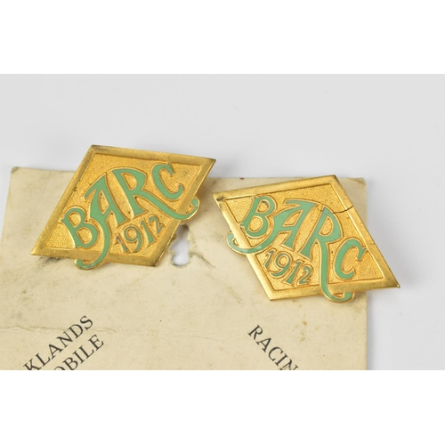 90 - A pair of 1912 Brooklands Automobile Racing Club badges, on original card, with green enamel, number...