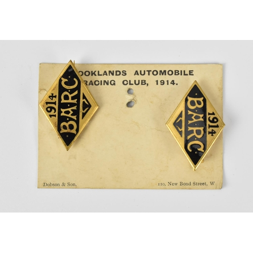 91 - A pair of 1914 Brooklands Automobile Racing Club badges, on original card, with black enamel, number...