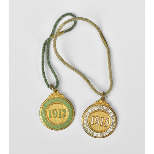 93 - Two Brooklands Automobile Racing Club medals, one with green enamel, the other white, numbers to the...