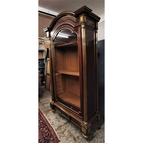 113 - A 19th century French brass mounted mahogany vitrine, the central arched glazed door with brass fram...
