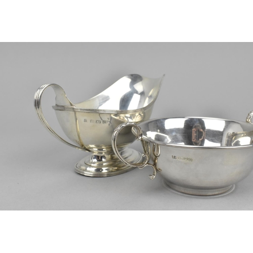 13 - An early 20th century silver sauceboat by S.W.Smith & co, Birmingham 1919, together with a silver tw...